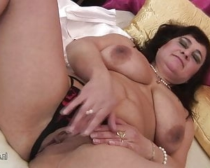 Big titted mature mom playing with herself