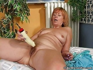 Redhead granny with hard nipples masturbates